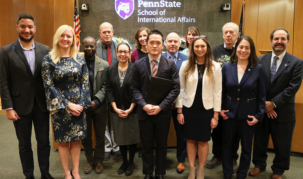 Fall 2018 graduates celebrated their achievement with SIA faculty and staff.