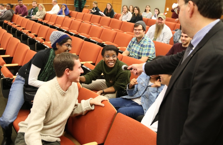 Students gathered in group talking through microphone