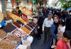 People shop in the Grand Bazaar in Tehran